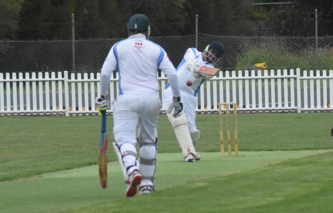 SHOT!: As Lachlan O'Keefe prepares to take off, Michael Parfett knocks the ball away nicely during a recent game against Cudal. Photo: Mark Logan.