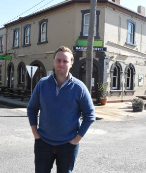 NEW ERA: Ben Cochrane outside the Railway Hotel in Millthorpe, he and his family officially took over ownership on Monday. Photo: MARK LOGAN
